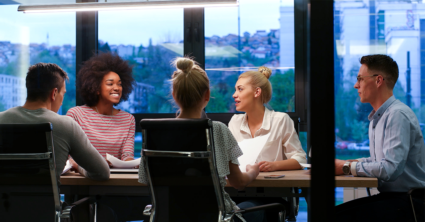 storyblocks-multiethnic-startup-business-team-on-meeting-in-modern-night-office-interior-brainstorming-working-on-laptop_SO8FzwIdhb1375x720